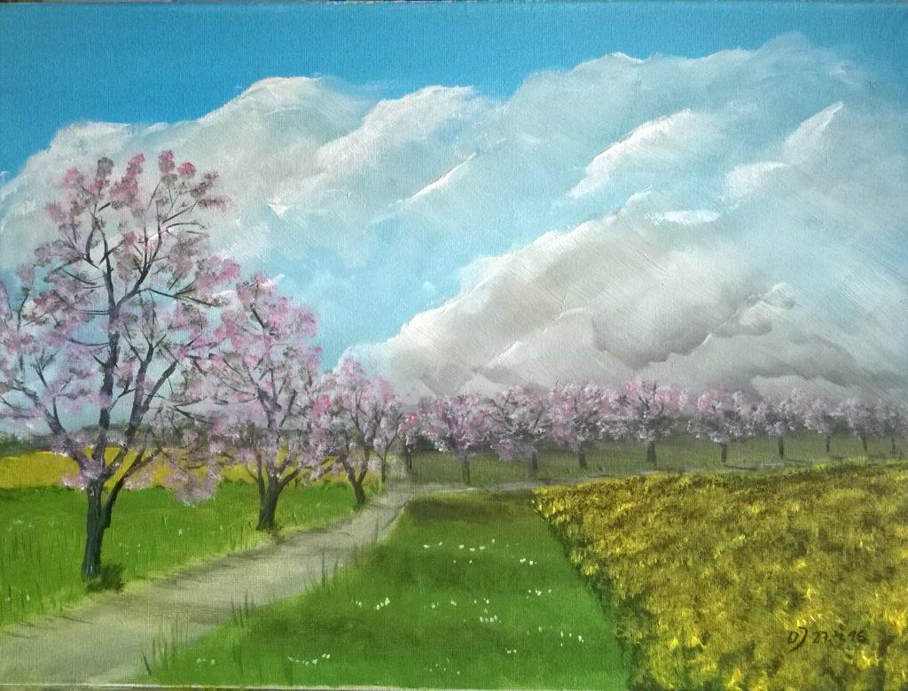 Fruehlingslandschaft-mit-bluehenden-Obstbaeumen